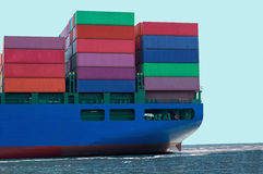 Container Ship With Cargo Containers. Cargo ship hauling colorful cargo containers Stock Photo