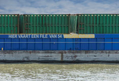Container ship. Cargo containership on the water near the harbour of Rotterdam in the Netherlands, presented as an environmentally friendly alternative for stock image