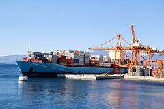 Container ship for carriage of goods with containers to shore in port ship port on horizon. Container ship for carriage of goods with containers to shore in Royalty Free Stock Image