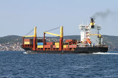 Container ship carrying goods Stock Photos