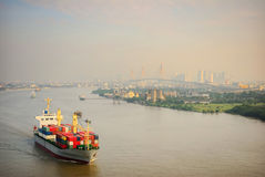 A container ship  in a Chao Phra ya River Royalty Free Stock Photos