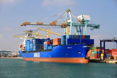 Container ship Cincia A docked in Valencia in containers terminal dock. Stock Photo