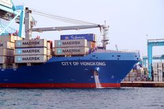 Container ship City of Hongkong working with containers cranes. Stock Photos