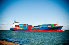 Container ship coming into port Stock Photo