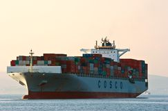 Container ship COSCO Phillipines on the high seas.  East (Japan) Sea. Pacific Ocean. 01.08.2014 Royalty Free Stock Image