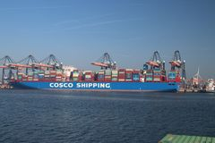 Container ship of cosco shipping in the canal Yangtzekanaal. This is in the harbor Maasvlakte of port of Rotterdam. Container ship of cosco shipping in the stock image