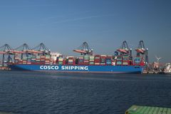 Container ship of cosco shipping in the canal Yangtzekanaal. This is in the harbor Maasvlakte of port of Rotterdam. Container ship of cosco shipping in the royalty free stock image