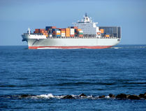 Container Ship with Deck Cargo Load Sailing at Sea stock photography