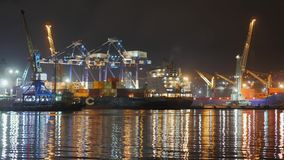 Container ship at deep sea port at night, Business import export logistic and transportation of International by. Container cargo ship in the open sea, Aerial stock video