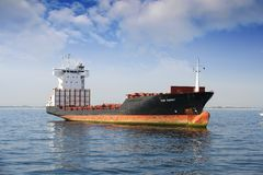 Container ship docked empty close to the port of Valencia. Royalty Free Stock Photo