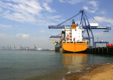 Container ship at the docks. A container ship unloading at the docks Royalty Free Stock Photography