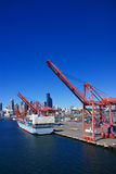 Container ship and dockyard cranes Stock Images