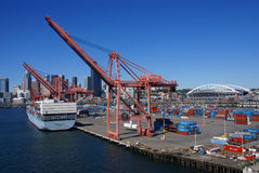 Container ship and dockyard cranes, Seattle waterfront Royalty Free Stock Image