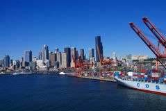Container ship and dockyard cranes, Seattle waterfront Royalty Free Stock Photography