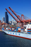 Container ship and dockyard cranes, Seattle waterfront Royalty Free Stock Photos