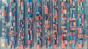 Container ship in export and import business and logistics. Ship. Ping cargo to harbor by crane. Water transport International. Aerial view stock photos