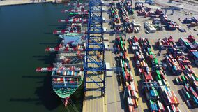 Container ship in export and import business and logistics. Shipping cargo to harbor by crane. Water transport International.
