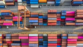 Container ship in export and import business and logistics. Shipping cargo to harbor by crane. Water transport International. Aerial view and top view royalty free stock photos