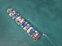 Container ship in export and import business and logistics in th Royalty Free Stock Images