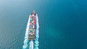 Container ship in export and import business logistics and transportation. Cargo and container box shipping to harbor by crane. stock photography