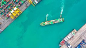 Container ship in export and import business logistics and transportation. Cargo and container box shipping to harbor by crane. royalty free stock images