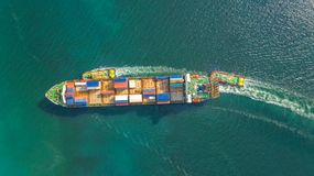 Container ship in export and import business logistics and transportation. Cargo and container box shipping to harbor by crane. royalty free stock photography