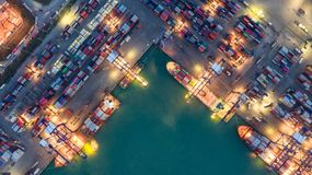 Container ship in export and import business logistics and transportation. Cargo and container box shipping to harbor by crane. royalty free stock photos