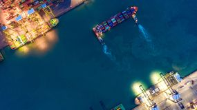Container ship in export and import business logistics and transportation. Cargo and container box shipping to harbor by crane. royalty free stock image