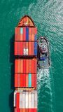 Container ship in export and import business logistics and transportation. Cargo and container box shipping to harbor by crane. stock photo