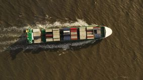 Container ship in export and import. International shipping cargo. Aerial view stock video