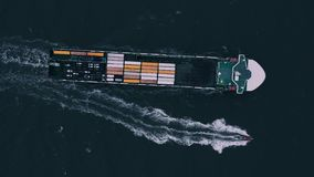 Container ship in export and import. International shipping cargo. Aerial view stock video footage