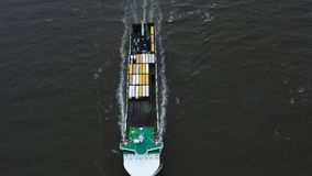 Container ship in export and import. International shipping cargo. Aerial view stock footage