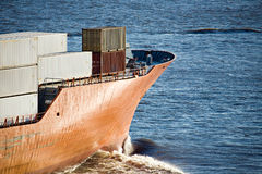 Container ship freighter heading out to sea. Container ship freighter closeup heading out to sea Royalty Free Stock Images