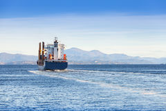 Container ship goes on Norwegian sea, rear view Royalty Free Stock Photos