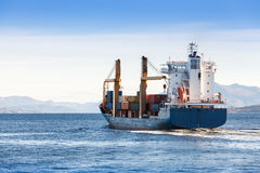 Container ship goes on Norwegian sea, Trondheim Stock Images
