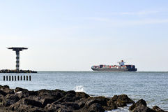 Container ship going out of the harbor stock image