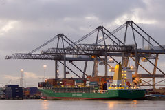Container ship harbor cranes Stock Images