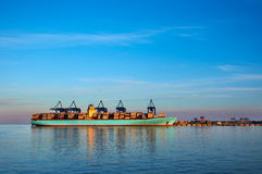 Container ship in harbor of Gdansk, Poland. Evening, sunset, colorful scene of industrial landscape. Royalty Free Stock Photos