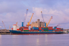 Container ship in the harbor. Royalty Free Stock Images
