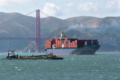 Container ship heads through the Golden Gate Royalty Free Stock Image
