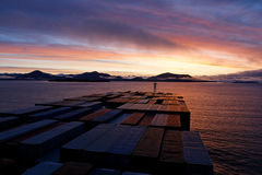 Container ship heads into Prince Rupert at sunrise. View from the bridge deck of a container ship headed into the Port of Prince Rupert, British Columbia, Canada Stock Photo