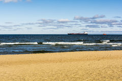 Container ship on the high seas. Container ship on the high seas as seen from the beach Royalty Free Stock Image