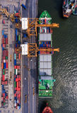 Container ship in import export and business logistic.By crane ,. Trade Port , Shipping.cargo to harbor.Aerial view.Top view Stock Images