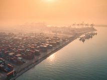 Container ship in import export and business logistic, By crane,. Trade Port, Shipping, cargo to harbor. Aerial view, Water transport International Royalty Free Stock Photography