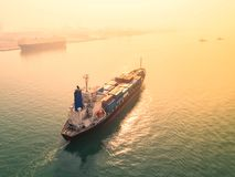 Container ship in import export and business logistic, By crane,. Trade Port, Shipping, cargo to harbor. Aerial view, Water transport International Royalty Free Stock Photo