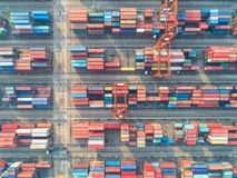 Container ship in import export and business logistic, By crane,. Trade Port, Shipping, cargo to harbor. Aerial view, Water transport International Stock Photo
