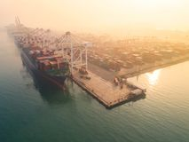 Container ship in import export and business logistic, By crane,. Trade Port, Shipping, cargo to harbor. Aerial view, Water transport International Stock Photos