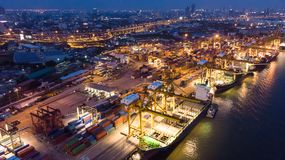 Container ship in import export and business logistic, Internati. Onal transportation, Business logistics concept,Aerial night view Royalty Free Stock Image