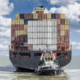 Container ship. Leaving the port of antwerp stock photos