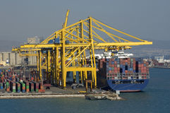 Container ship during load operations Stock Image